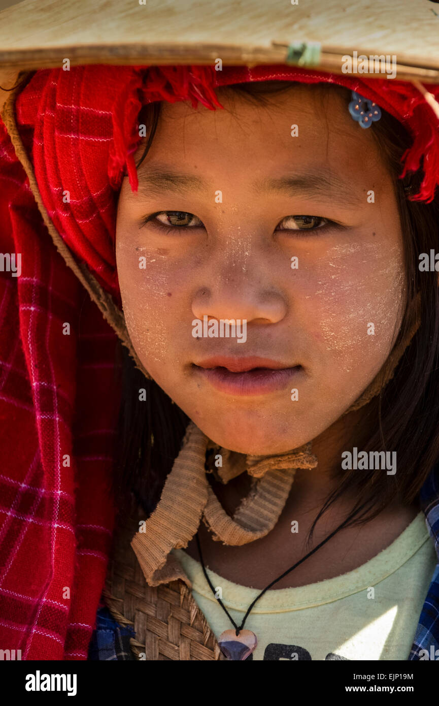 Scenes of rural Myanmar people at work young girl at the market - Stock Image