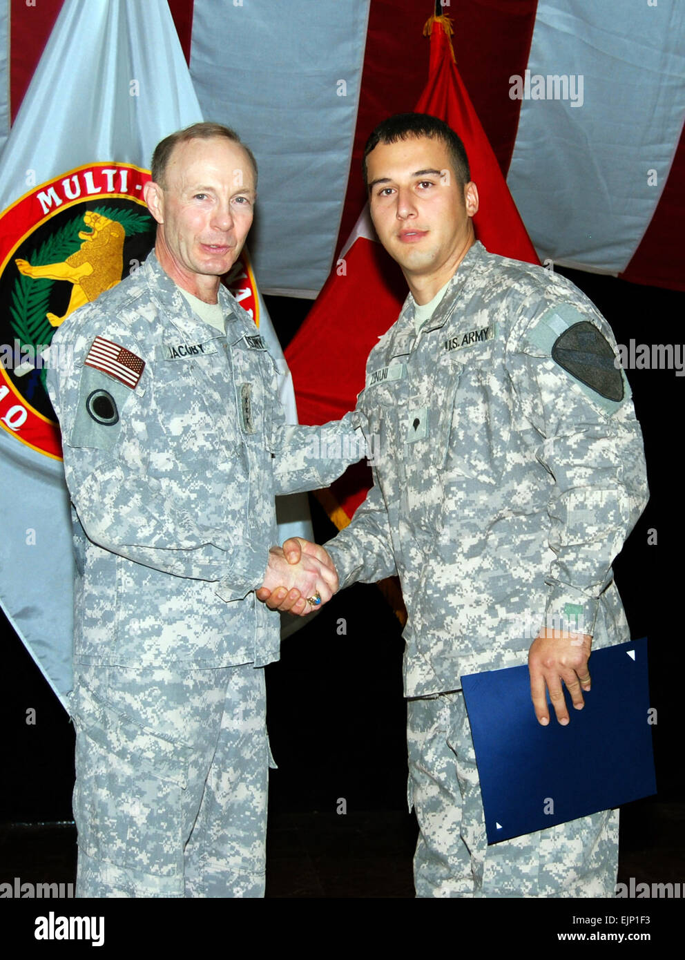 Lt. Gen. Charles H. Jacoby Jr., left commanding general of Multi-National Corps-Iraq, shakes the hand of Pfc. Daut - Stock Image