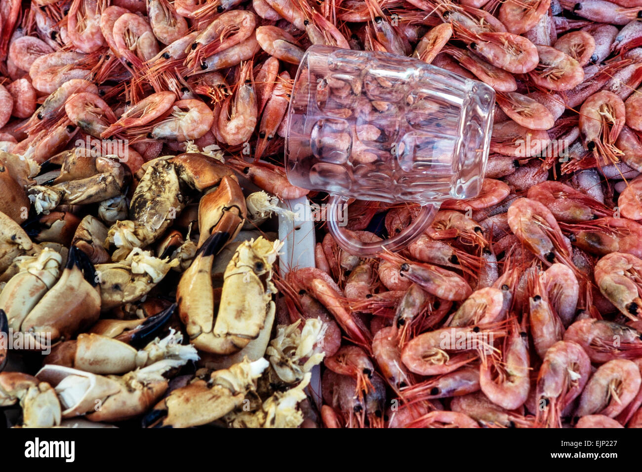 Cooked crab claws and prawns for sale. Great Yarmouth. Norfolk. UK - Stock Image