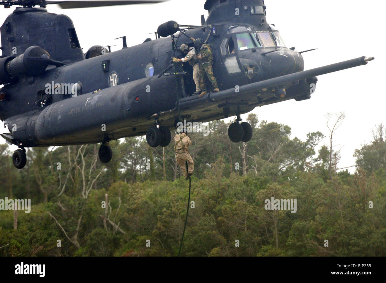 A U.S. Air Force Airman fast ropes from an MH-47 Chinook helicopter from an MH-47 Chinook helicopter assigned to U.S. Army 160th Special Operations Aviation Regiment on Fort Fisher in Kure Beach, N.C., Sept. 19, 2007. Airmen and Soldiers from Hurlburt Field, Fla., and Fort Campbell, Ky., participated in the two-week long training.  Airman Matthew R. Loken Stock Photo