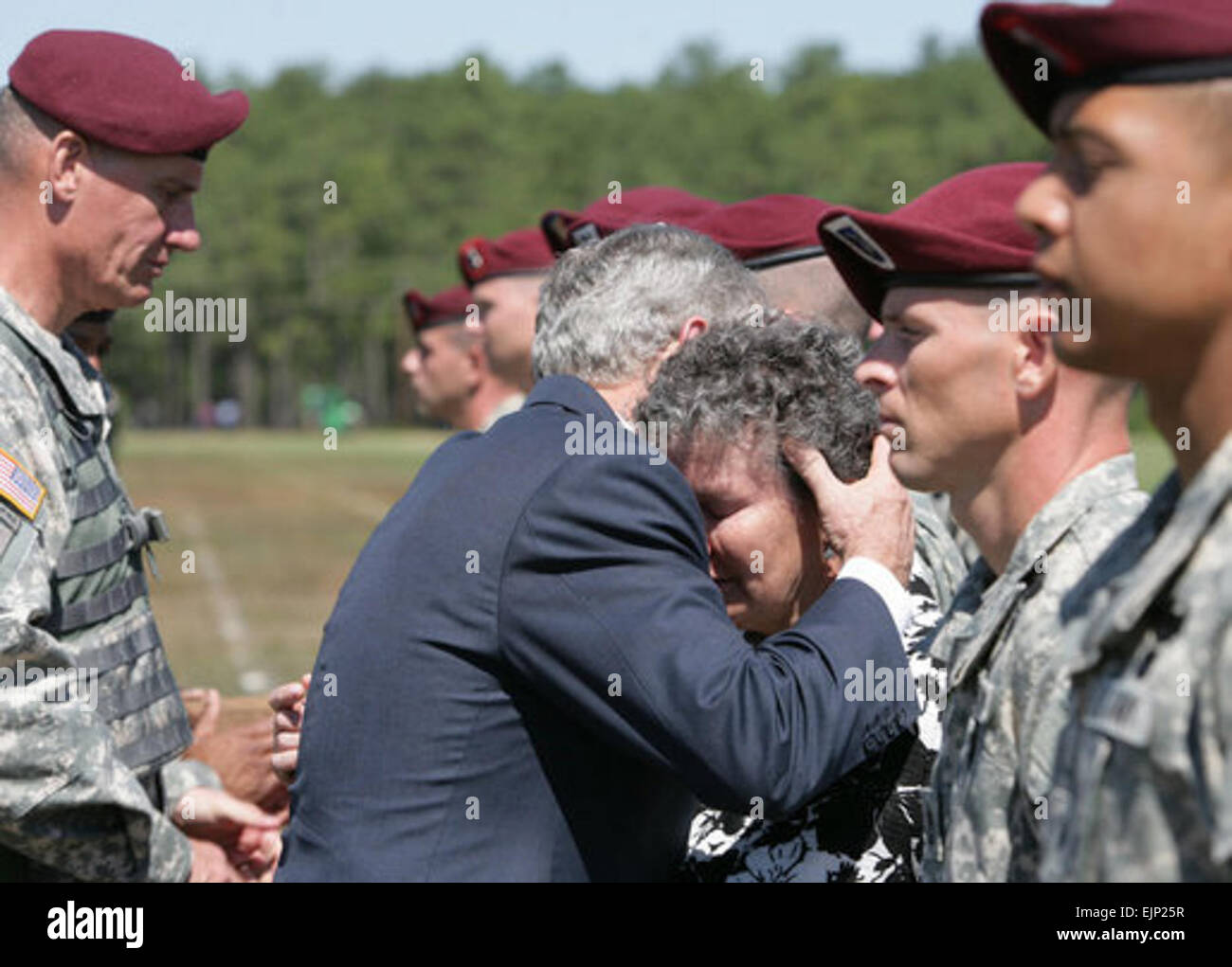 President George W. Bush embraces Barbara Walsh, mother of Sgt. First Class Benjamin Sebban, after receiving her - Stock Image