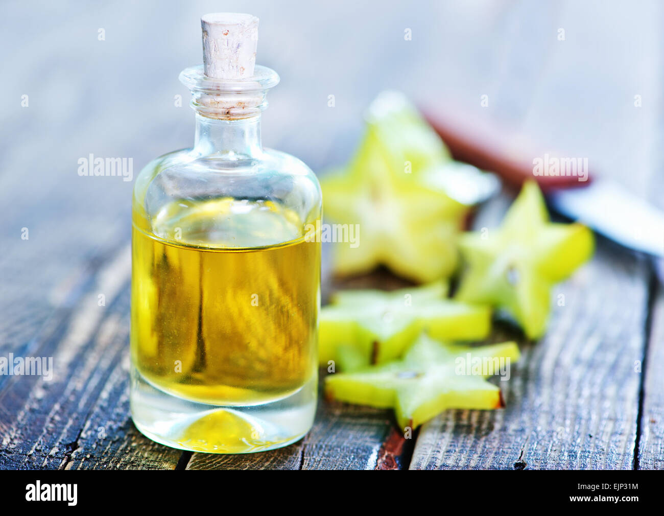 aroma oil in bottle and on a table - Stock Image
