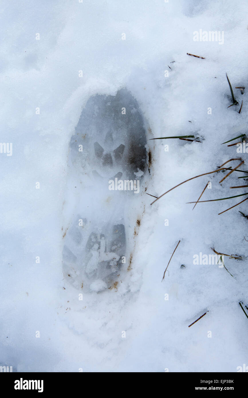Hikers footprint in the Snow Pennine Way Yorkshire - Stock Image