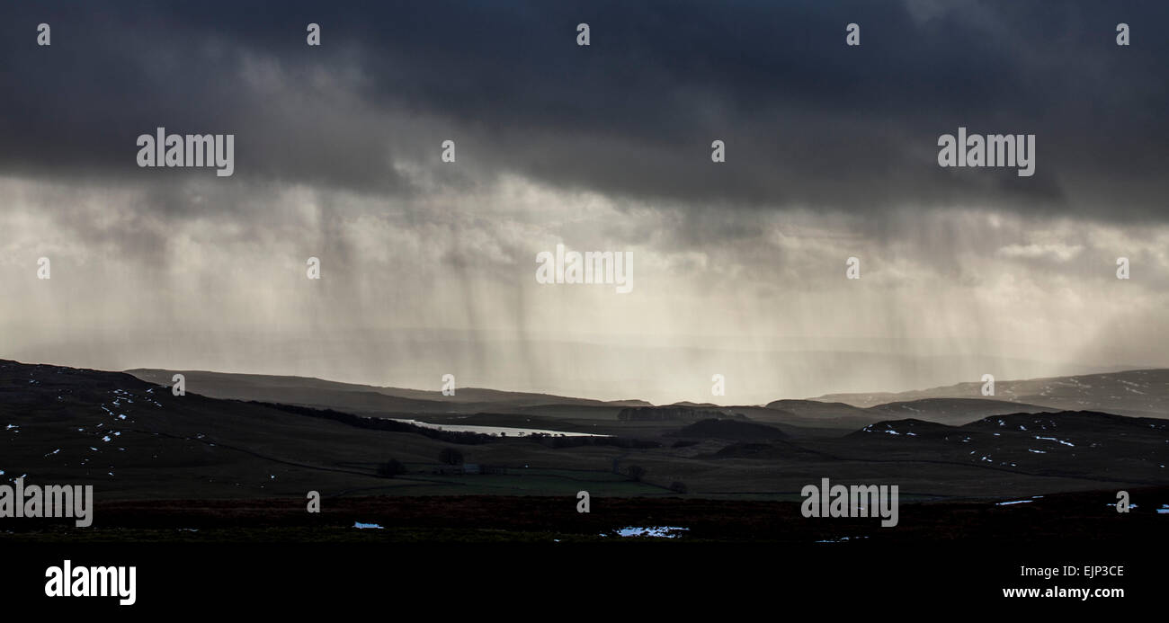 Dark clouds and snow above Malham Tarn on the Yorkshire Dales , North Yorkshire - Stock Image