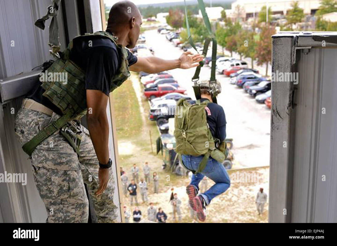 A Paratrooper's spouse jumps from the 34-foot-tower at the Advanced Airborne School for the 407th Brigade Support - Stock Image