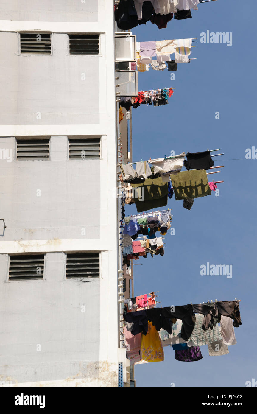 Drying clothes at public housing, Singapore. - Stock Image
