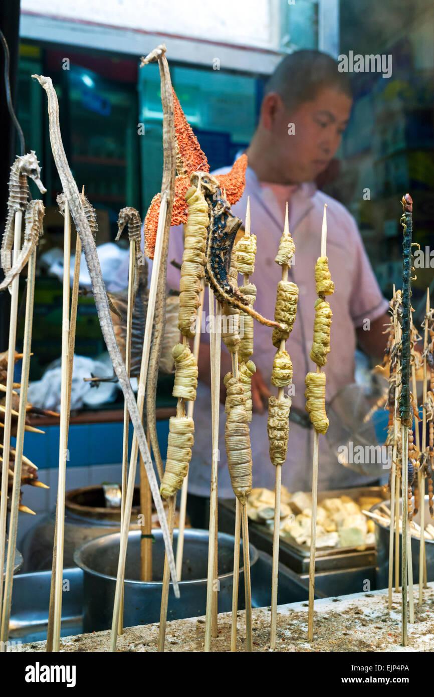 China, Beijing, exotic food on skewers, Wangfujing street night market - Stock Image