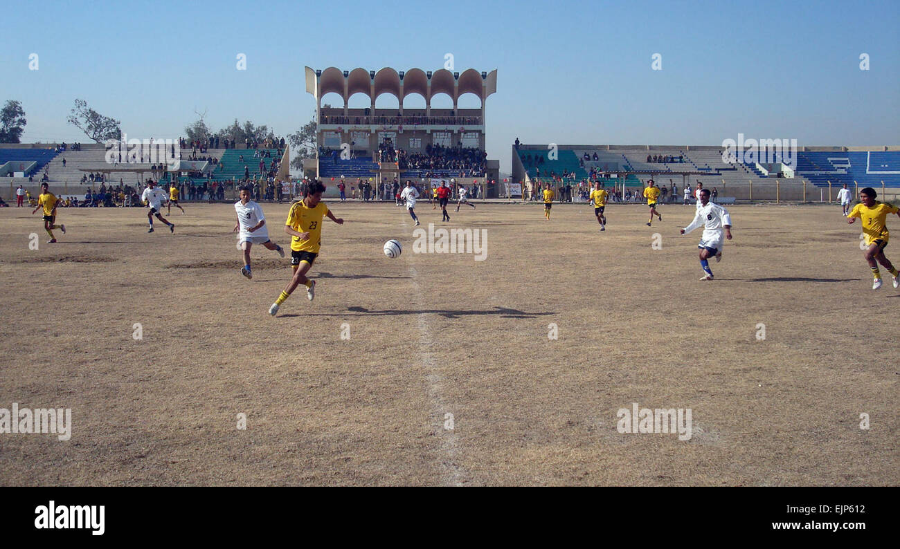 A midfielder from the Hammamiat Soccer Club gets ready to take a pass and turn up field at the Taji Soccer Club - Stock Image