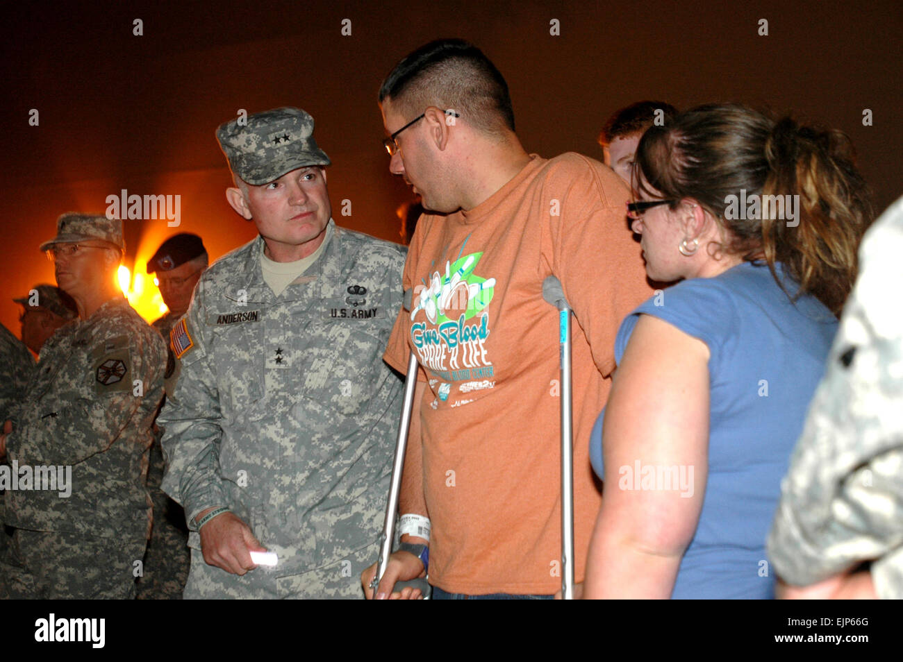 First Army Division West Commander Maj. Gen. Charles A. Anderson speaks with Pfc. James Armstrong and wife, Roxanne, - Stock Image