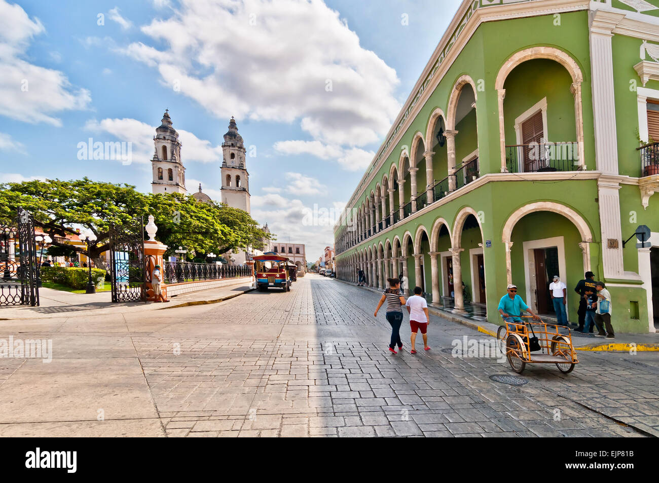 locals and tourists in main square with Cathedral in Campeche, Mexico. Stock Photo