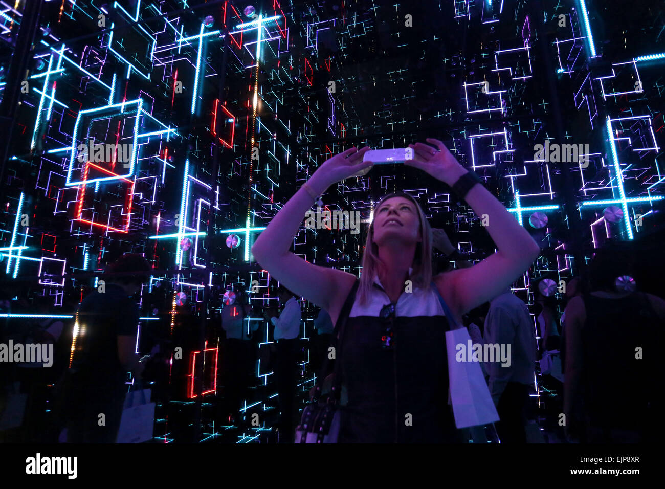 Sao Paulo, Brazil. 30th Mar, 2015. A visitor takes a picture during the exhibition Future Sensations to celebrate - Stock Image