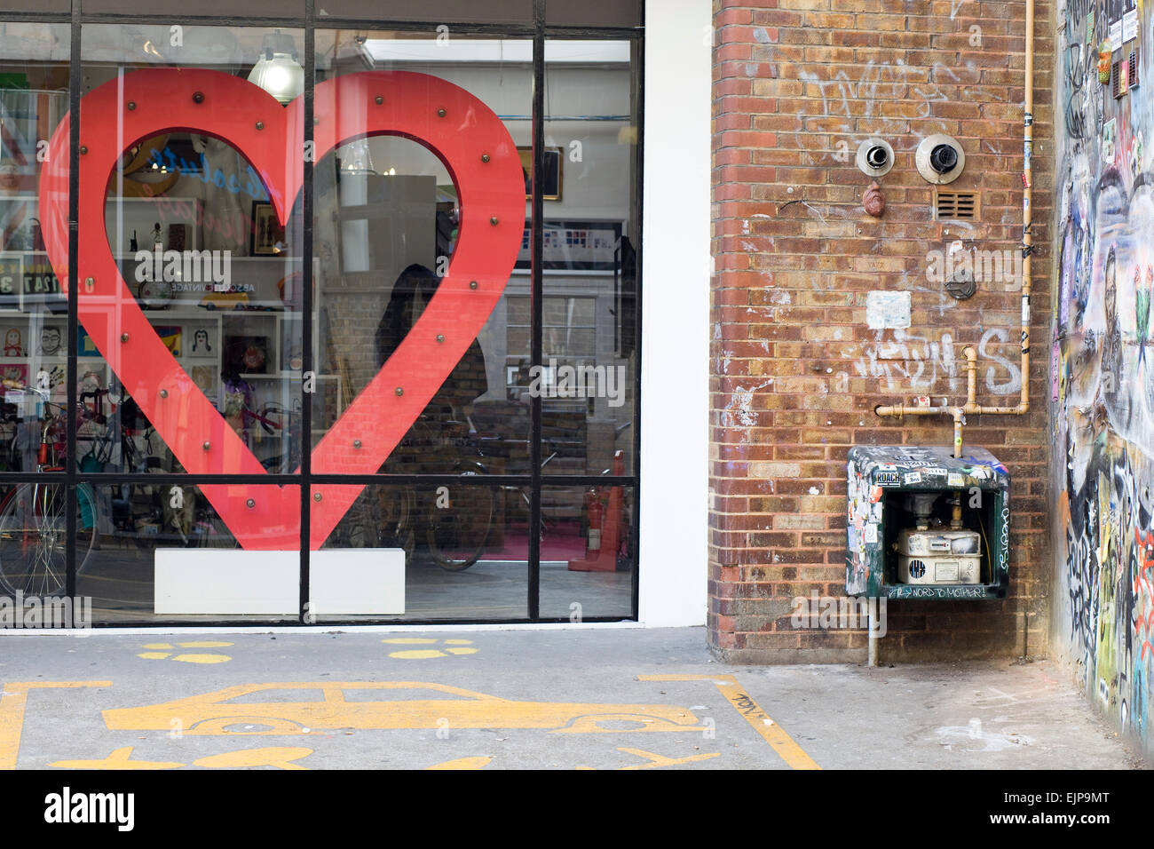 Graffiti wall art modern art giant heart behind glass doors