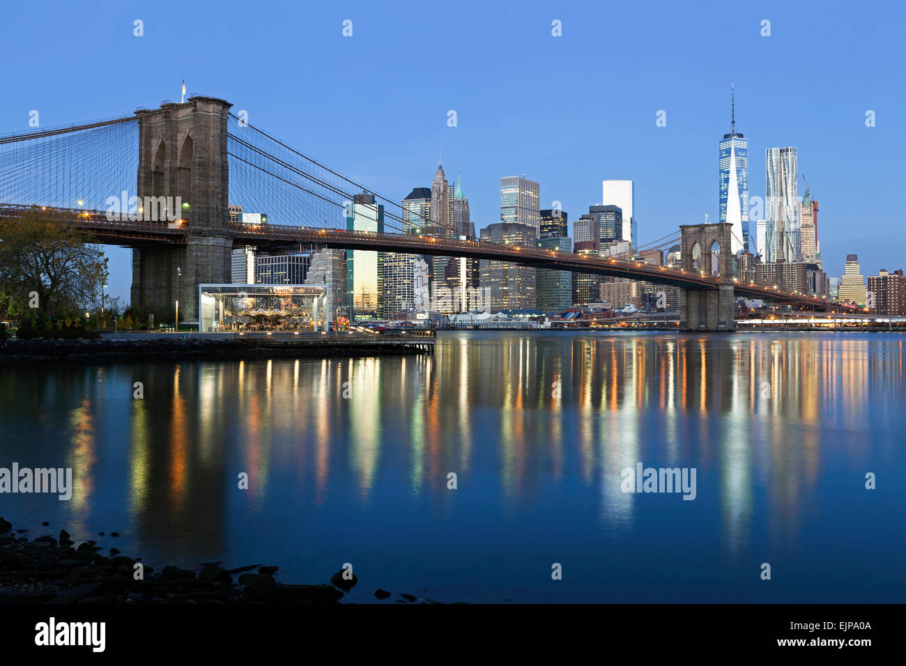 USA, New York City, Downtown Financial district of Manhattan, One World Trade Center and the Brooklyn Bridge Stock Photo