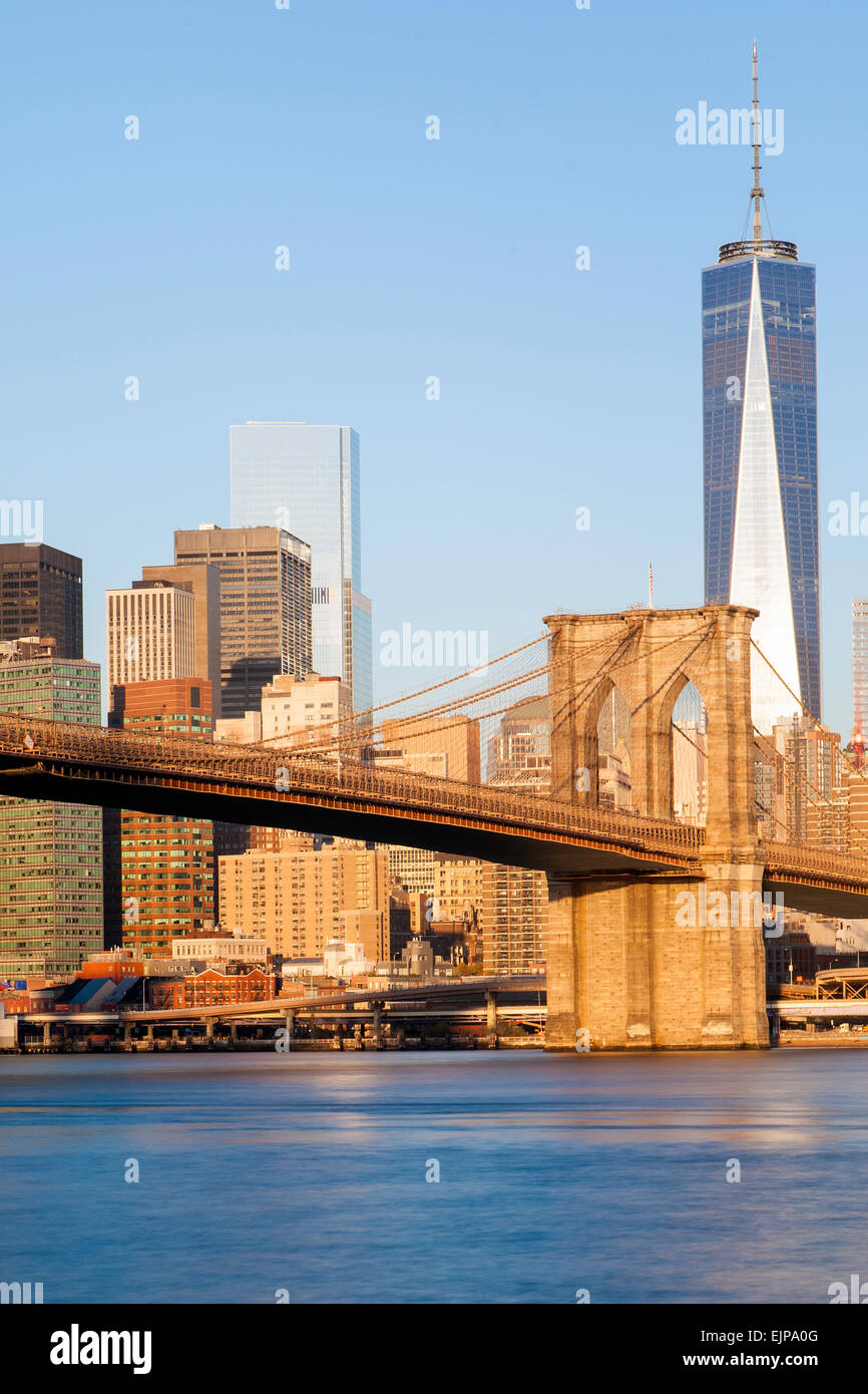 USA, New York City, Downtown Financial district of Manhattan, One World Trade Center and the Brooklyn Bridge - Stock Image
