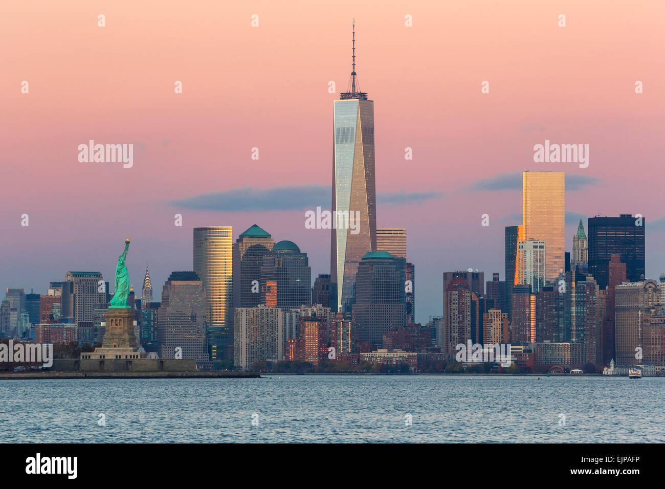 Statue of Liberty, One World Trade Center and Downtown Manhattan across the Hudson River, New York, Manhattan, United - Stock Image