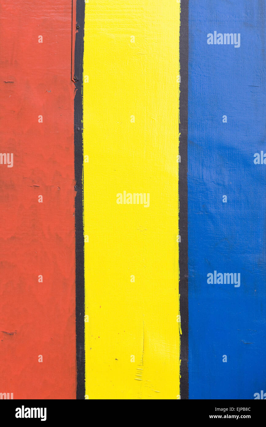 Planks of wood painted in Bright Colors - Stock Image