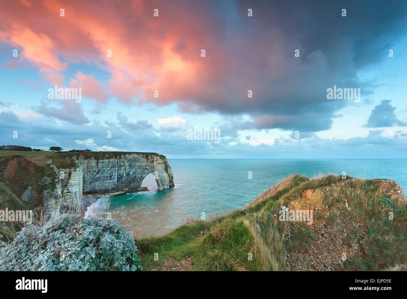 beautiful sunrise on Atlantic ocean coast, Etretat, France - Stock Image