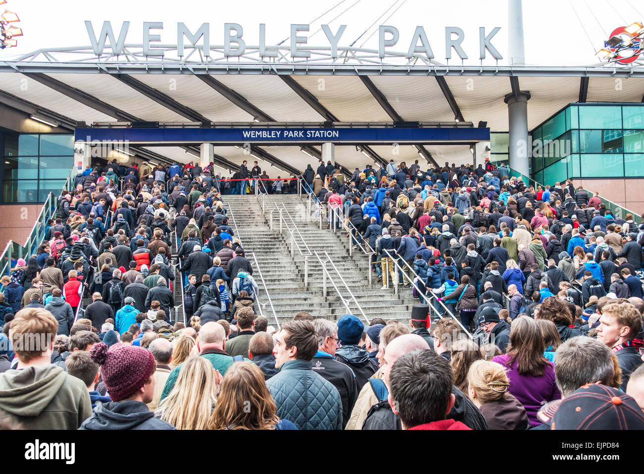 Large Crowd heading for tube trains after rugby game at Wembley Stadium. Wembley Park Station - Stock Image