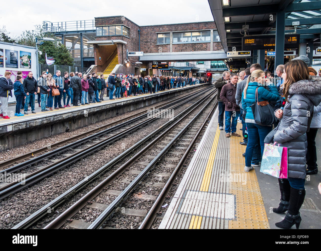 Large Crowd waiting for tube train. Wembley Park Station - Stock Image