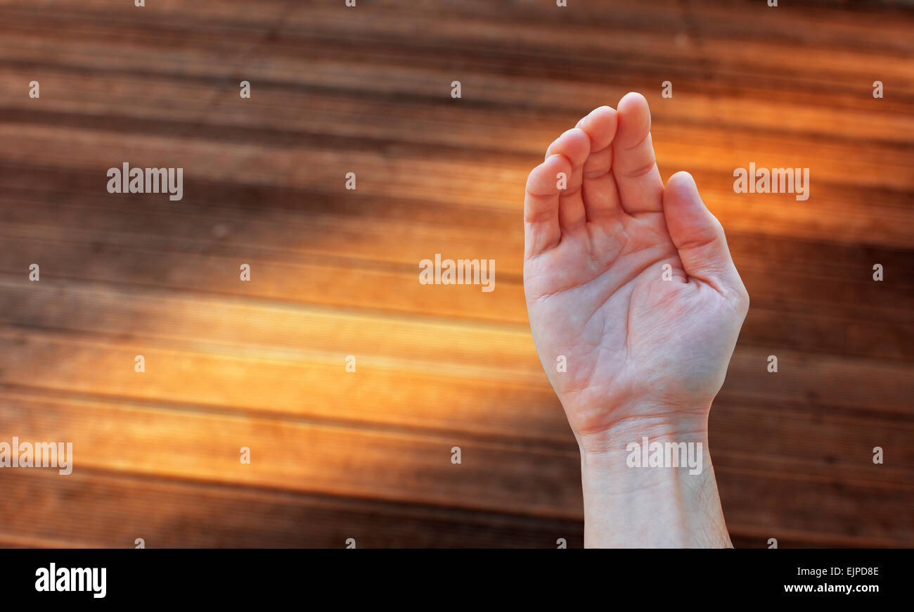 Open hand begging and blur background. - Stock Image