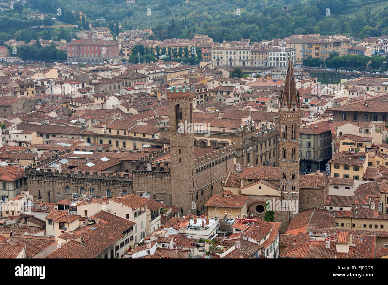 Florence cityscape with Badia Fiorentina and Palazzo del Bargello in the fog. Aerial view. Italy. Stock Photo