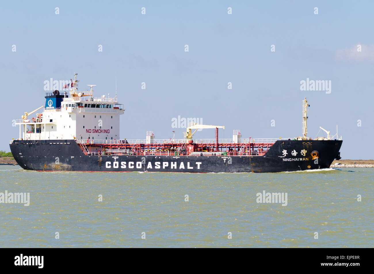 Asphalt / bitumen tanker Ning Hai Wan heading out toward the Gulf of Mexico in the Corpus Christi ship channel. - Stock Image