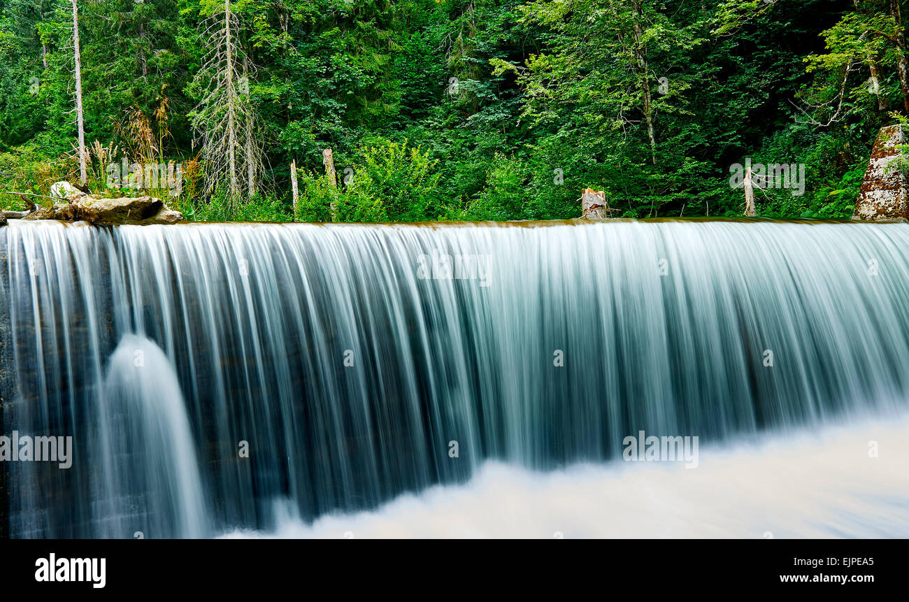 Forest waterfall with water curtain. - Stock Image