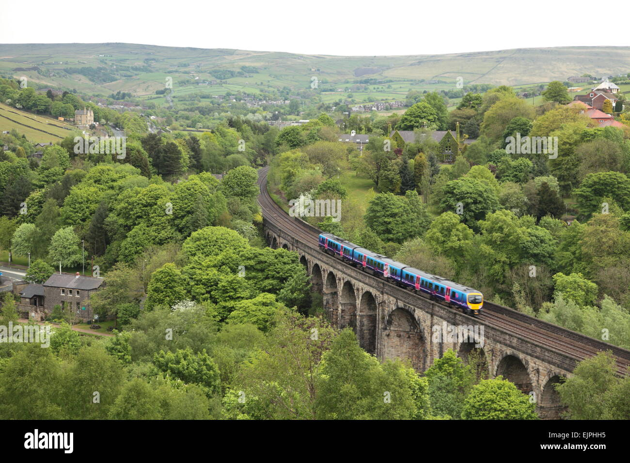 A First TransPennine express train crossing the viaduct at Brownhill, Dobcross, England heading for Manchester. - Stock Image