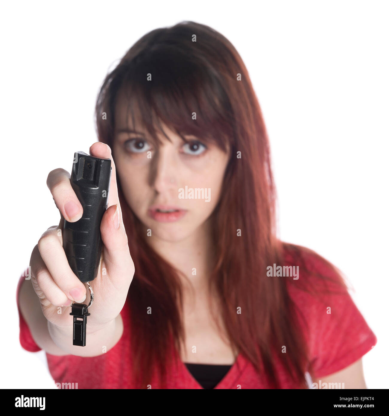 Serious Young Woman Holding Black Tear Gas Spray - Stock Image