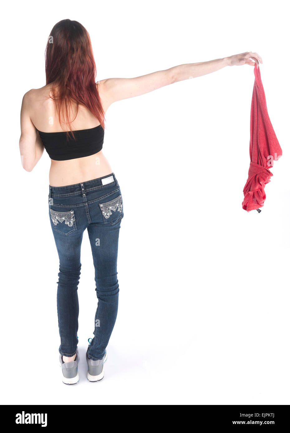 Rear View of a Woman Holding her Shirt on the Side - Stock Image