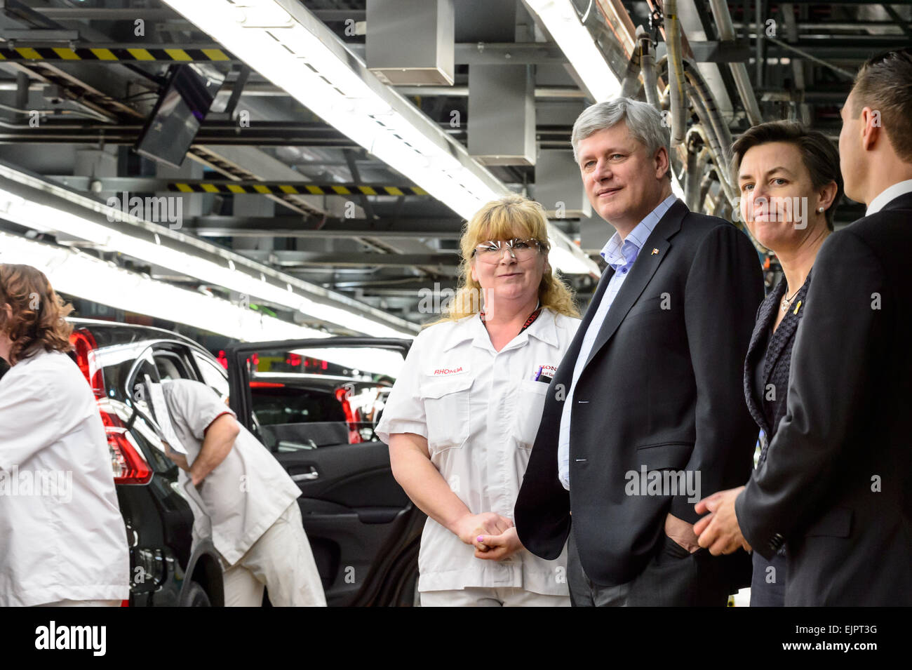 Alliston, CAN., 30 Mar 2015 - Canadian Prime Minister Stephen Harper was joined by Kellie Leitch, Minister of Labour - Stock Image
