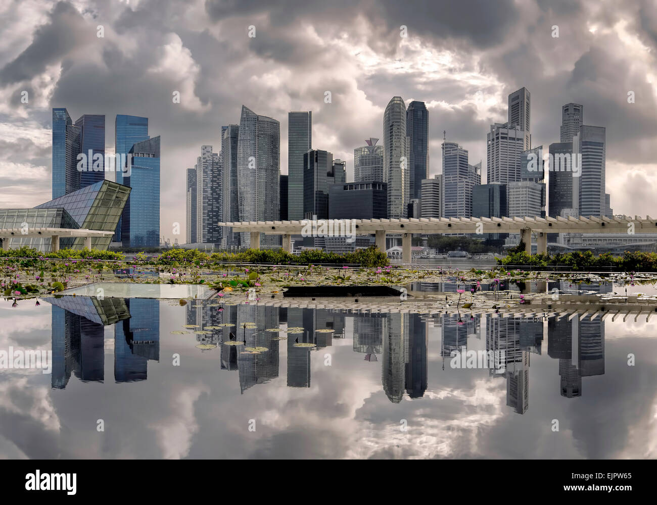 Reflections and clouds at marina bay, Singapore - Stock Image
