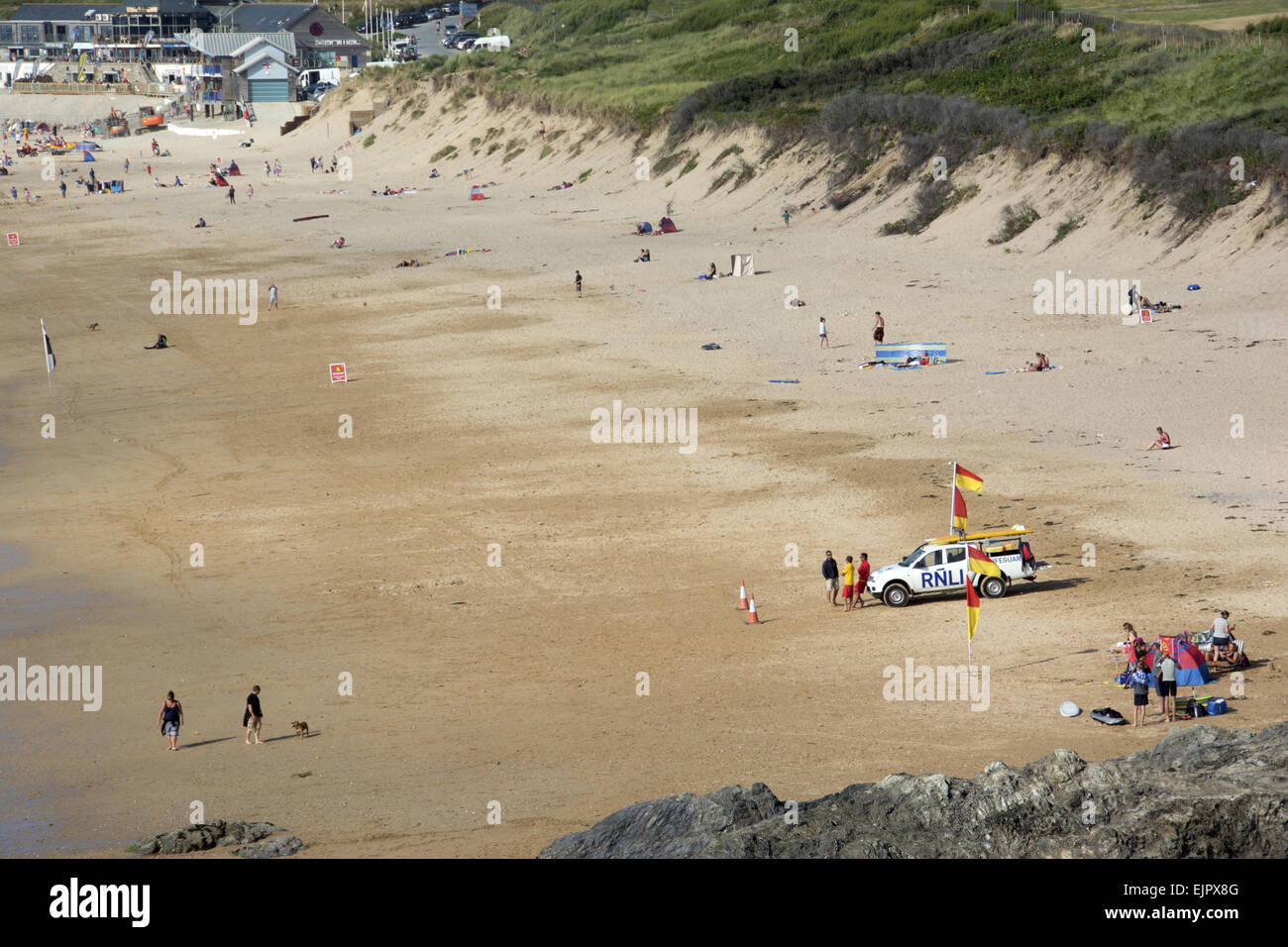 View of sandy beach with RNLI Lifeguards on standby, Fistral Beach, Fistral Bay, Newquay, Cornwall, England, July Stock Photo