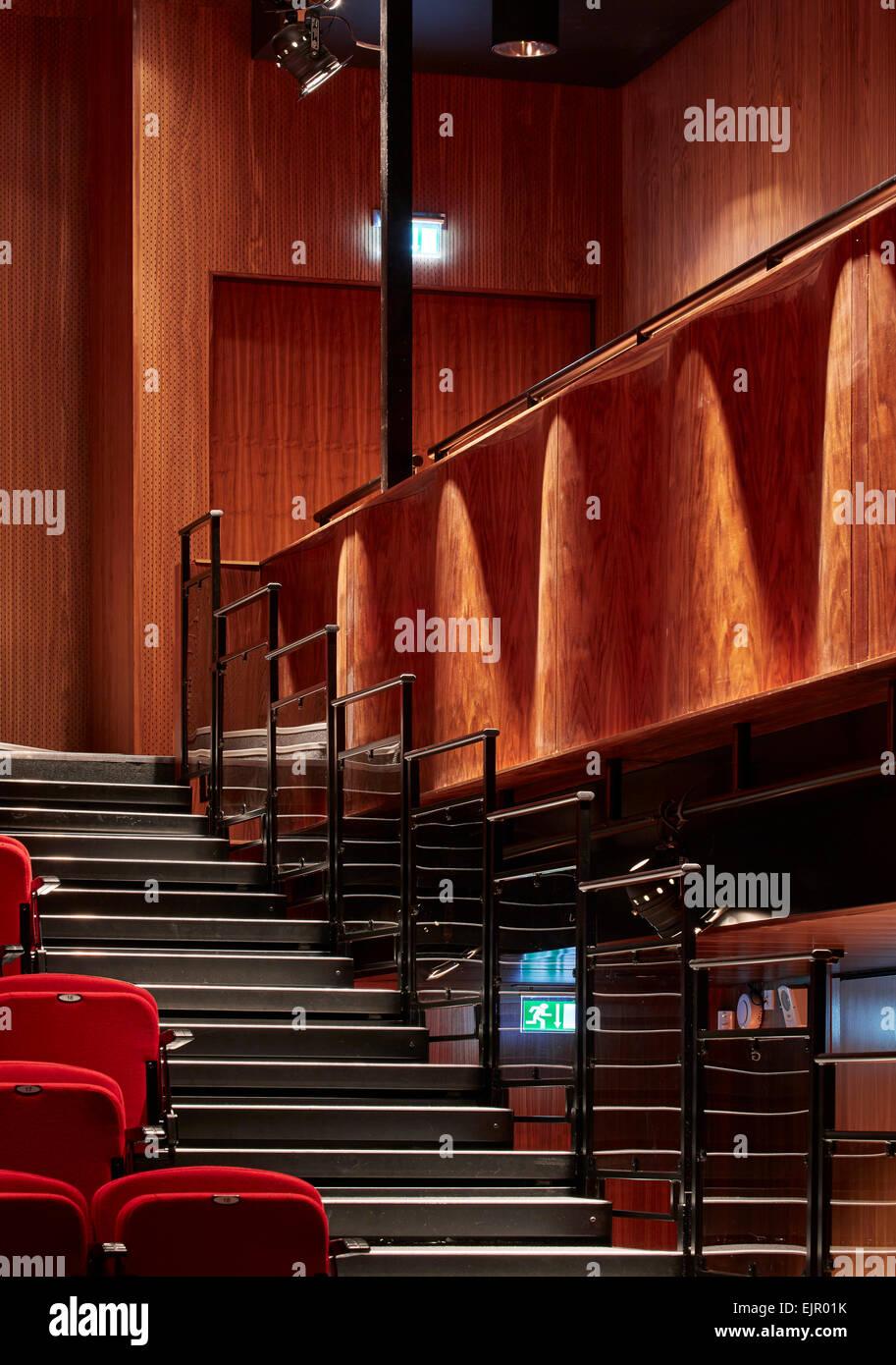 Detailed view retractable bleachers and acoustic walnut baffle. Lady Eleanor Holles School, Hampton, United Kingdom. - Stock Image