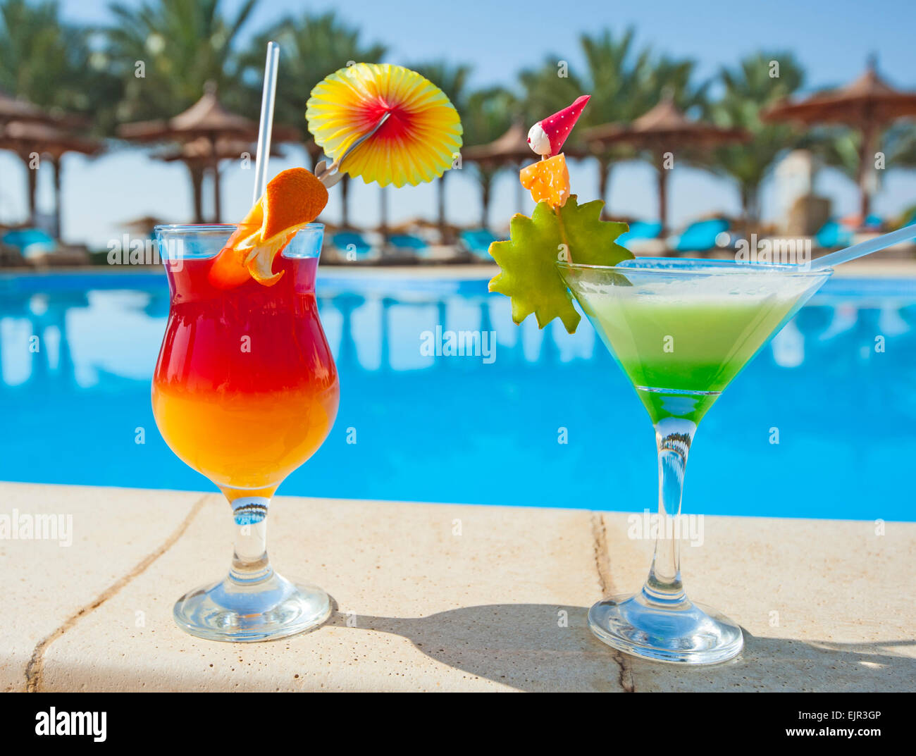Two Cocktail Drinks By A Tropical Resort Swimming Pool
