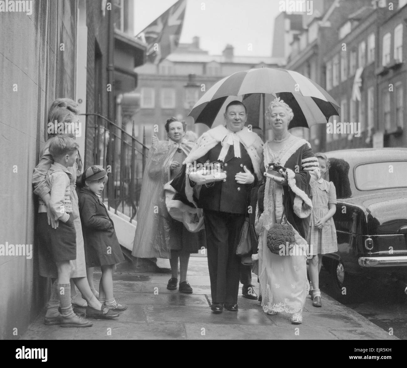 The Coronation of Queen Elizabeth II. Lord Gifford leaving for Westminster Abbey with his wife. 2nd June 1953. Stock Photo