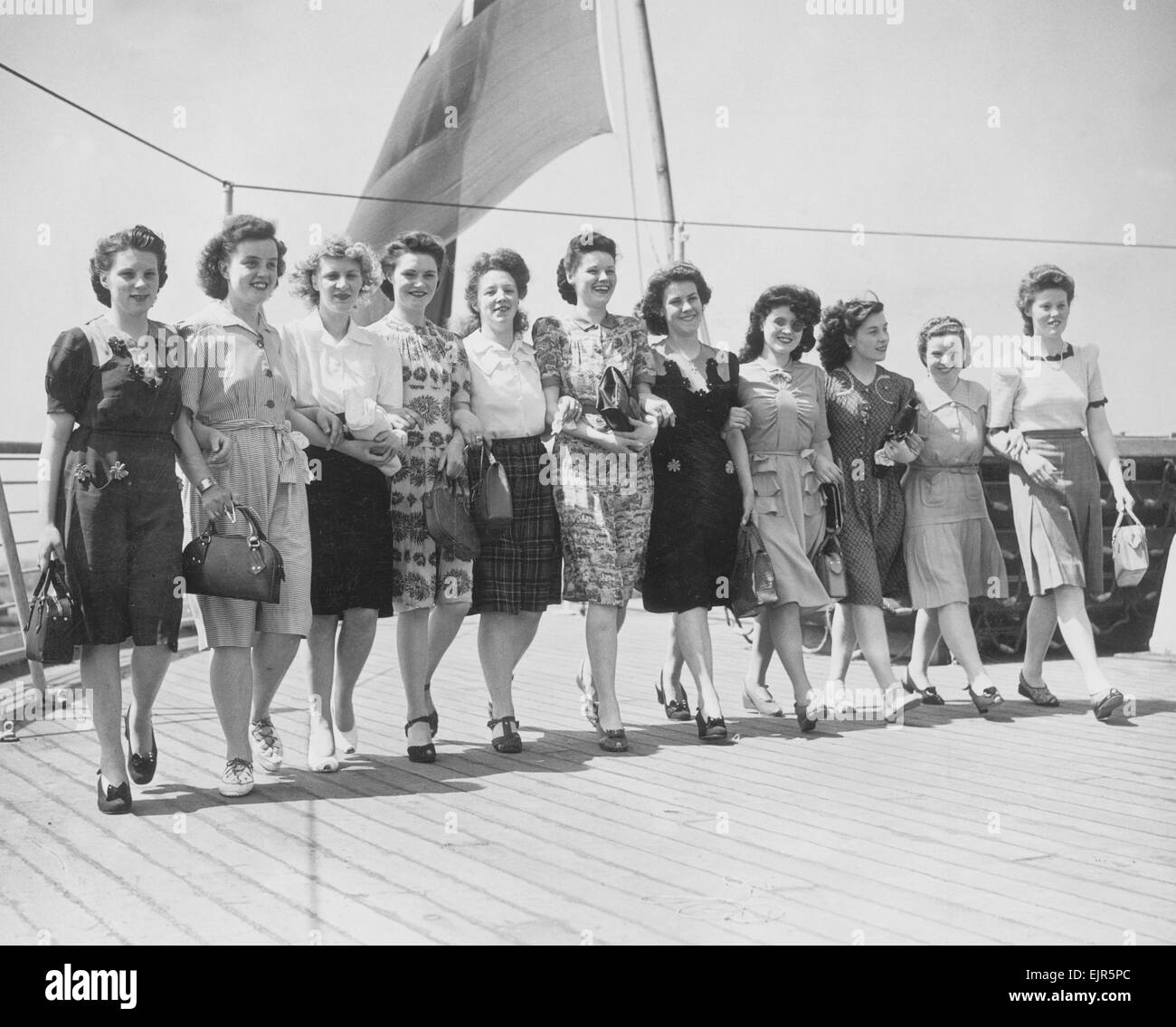 Eleven Glasgow girls took their last look at England when they sailed on the Orion for Australia. They are members - Stock Image