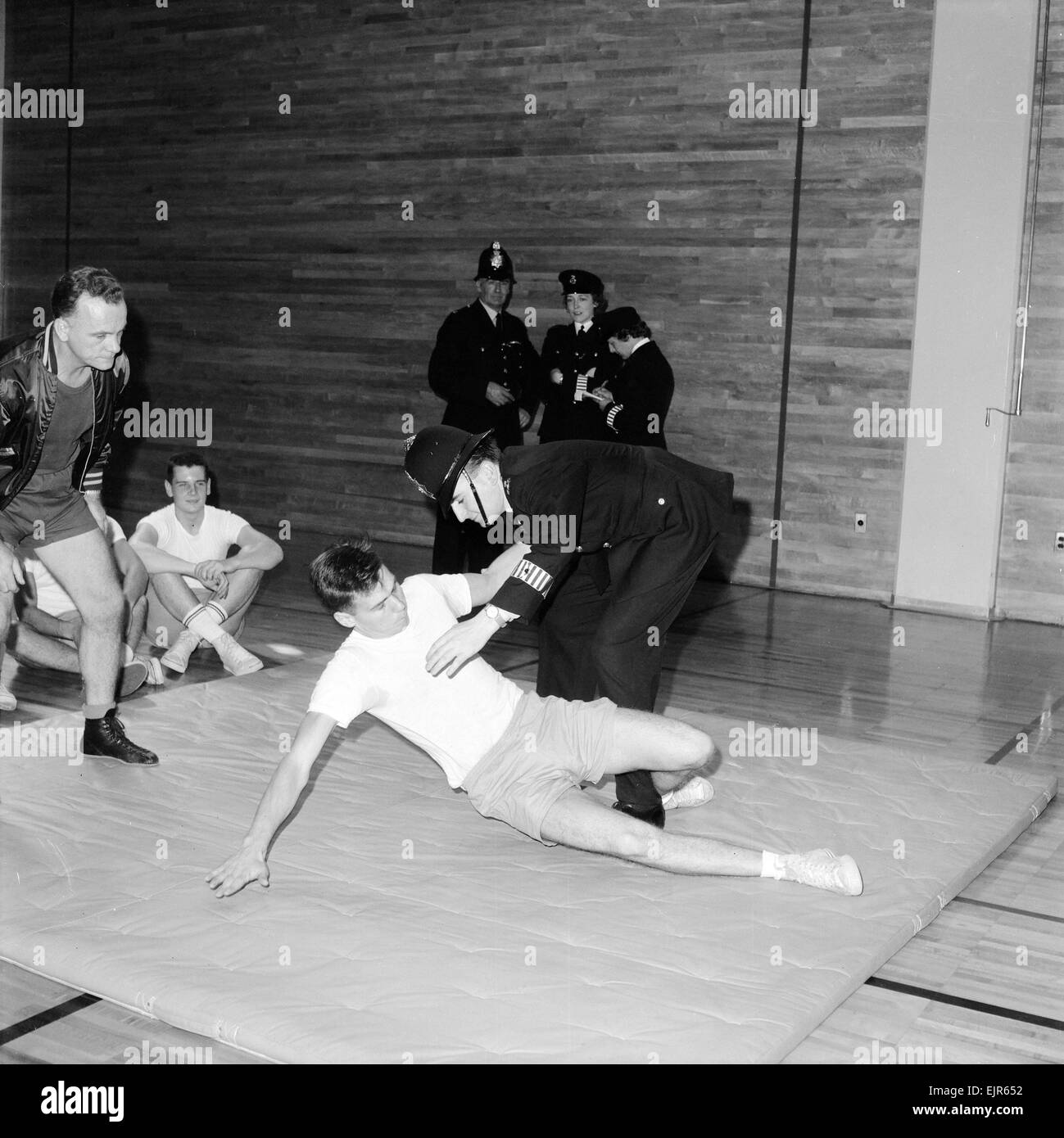 English police officers watch & take part in a hand to hand fighting training session at a Police Academy in - Stock Image