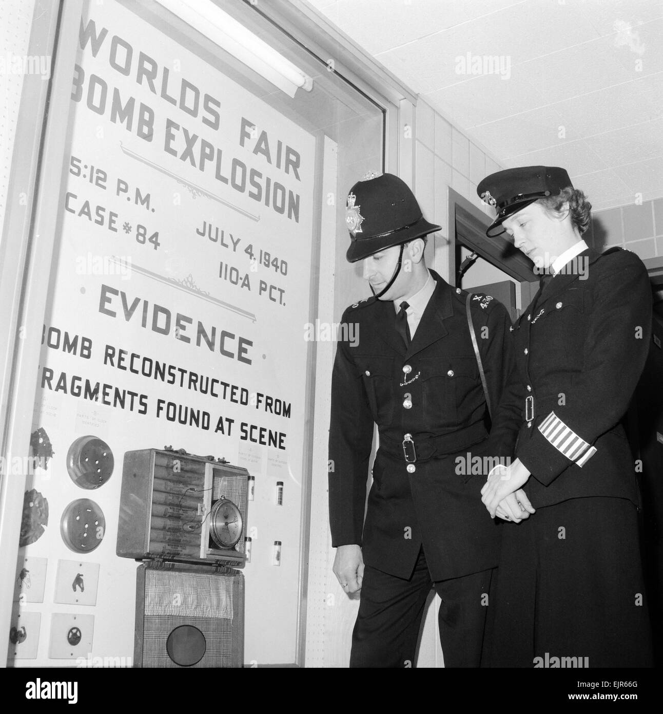 English police officers visit World's Fair in New York 2nd October 1964. Pictured examining exhibit which consists - Stock Image