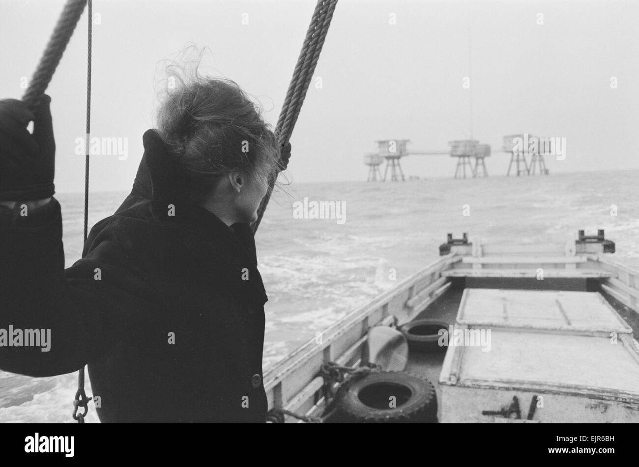 Dorothy Calvert widow of Reg Calvert, arriving at home of pirate radio station Radio City at Shivering Sands Fort - Stock Image