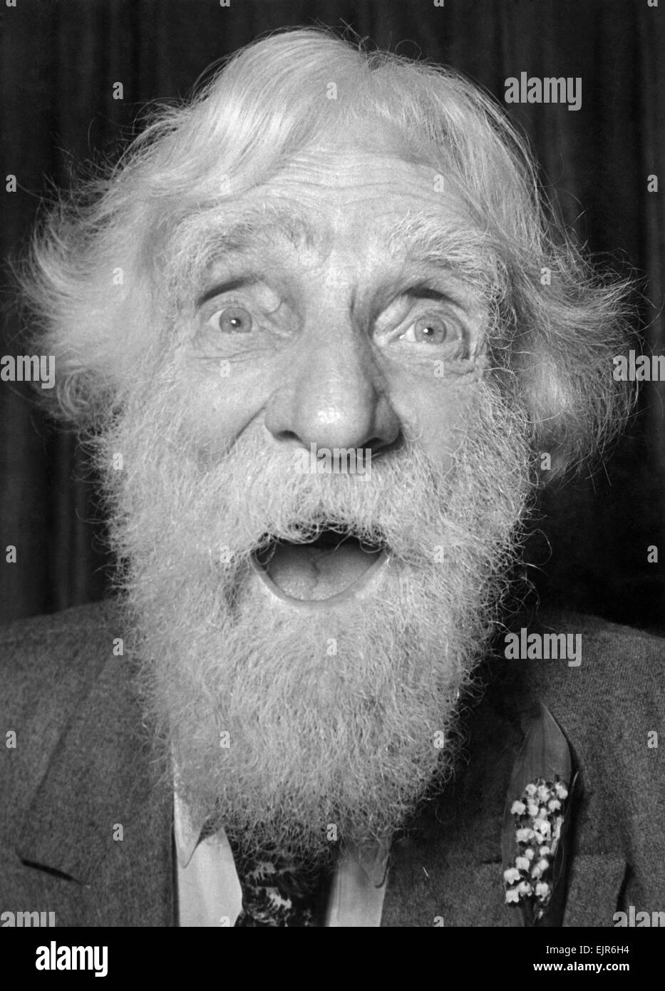 Old man with eyes wide open, looking into camera 25th May 1950. *** Local Caption *** Pensioners OAP Senior Citizens - Stock Image