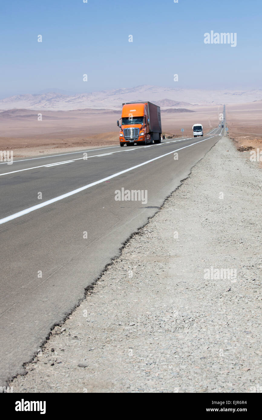 Lorry on desert road, Chile - Stock Image