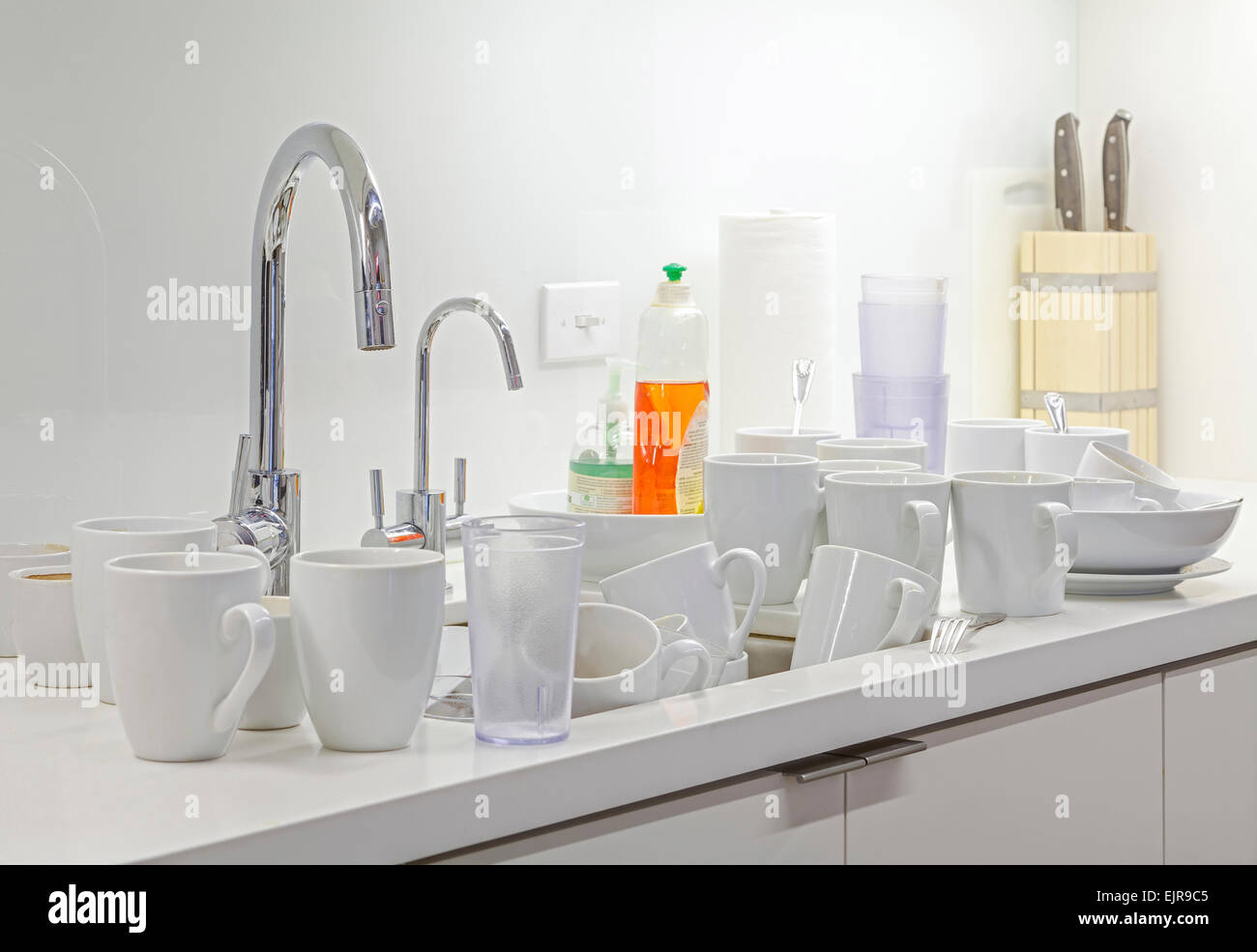 Dirty dishes near kitchen sink Stock Photo