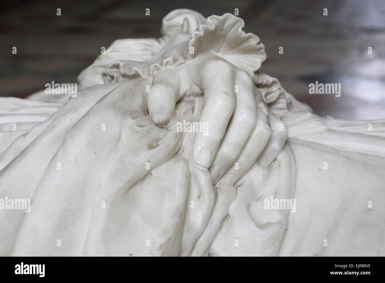 Hands on a marble memorial to William Connor Magee (1821 - 1891) at the cathedral in Peterborough, United Kingdom. - Stock Image