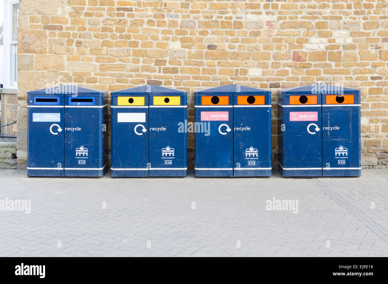 Row of blue public recycling bins in Market Harborough, Leicestershire Stock Photo