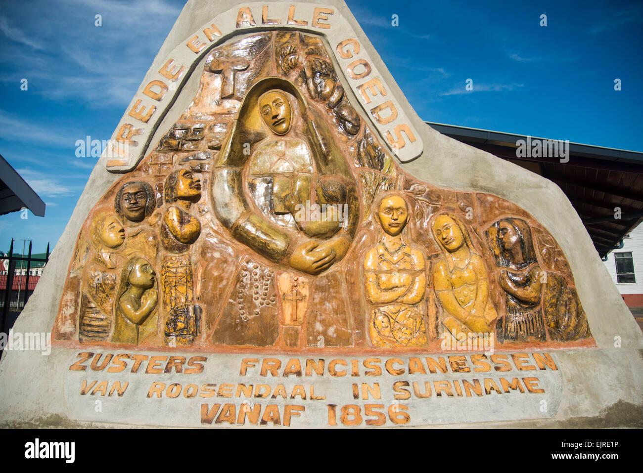 Frieze outside The Roman Catholic Diocese of Paramaribo, erected 1817, Paramaribo, Suriname - Stock Image