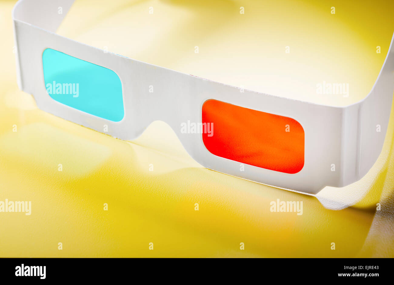 Disposable cardboard 3D Anaglyph glasses with cyan/red lenses. - Stock Image