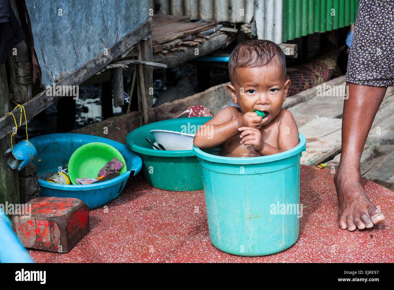Image result for child be bath in street in cambodia