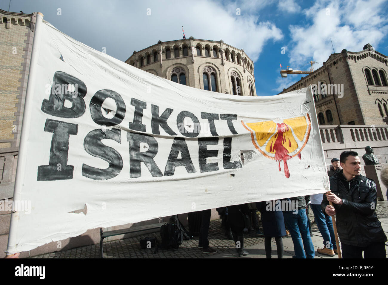 Solidarity activists hold a banner reading 'Boycott Israel' during a protest in front of the Norwegian Parliament - Stock Image