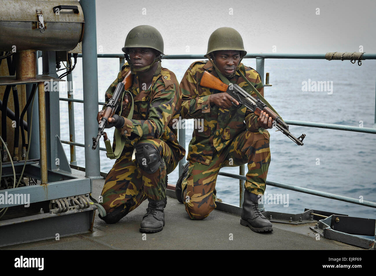 A Togolese naval boarding team provides security a simulated drug smuggling scenario as part of Obangame Express - Stock Image